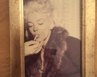 Marilyn Monroe smoking sepia print in a gold frame