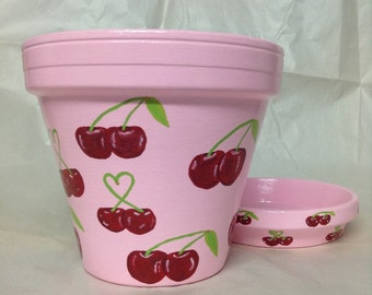 Hand painted pink flowerpot with red cherries. Garden decor. Garden art. Painted cherries. Painted fruit. Garden decor.