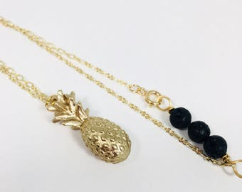 Gold pineapple diffuser necklace