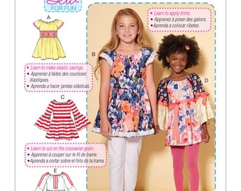 McCalls M7526 Learn to Sew Peasant Tops for Girls. Size 7-14. Pattern is new and uncut.