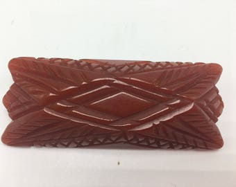 Lovely rusty/brown reddish colored  bakelite hand carved vintage brooch/pin