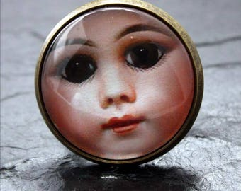 old doll face cabochon ring