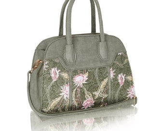 Green bag with floral pattern