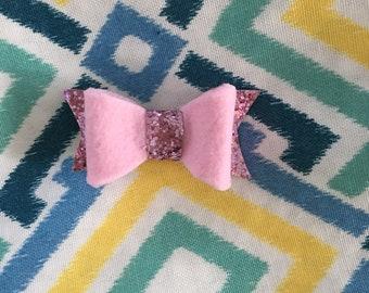 Pink felt and glitter canvas on an alligator clip