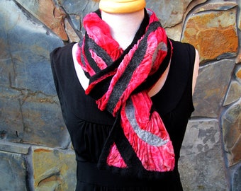 Black and gray merino wool line design on dyed red silk, nuno felt scarf