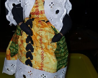 This is a Lovely handmade Doll with African Outfit