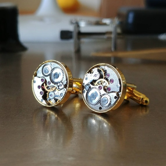 Cuff links with round mechanical watch movements