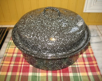 Black and white speckled enamel pan. Pot, dish.