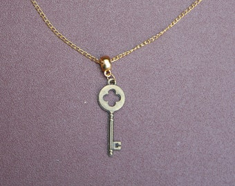 "Gold-plated key necklace with 8.5"" chain."