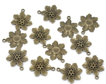 4 charms/pendants flower crimp metal bronze