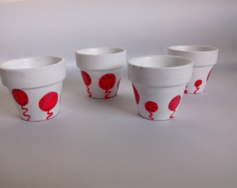 4 egg cups hand painted