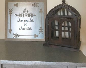 she believed she could so she did metal sign on stained wood background