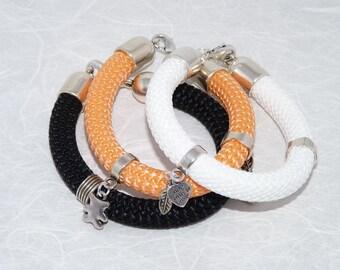 Sturdy bracelet, woven bracelet with sliders and charm, handmade, woman's bracelet, white, black, orange