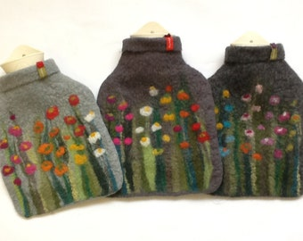 Hot water bottle with felted cover, grass and flowers, grey