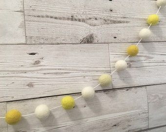 Primrose felt ball garland in yellow and neutral - pom pom bunting nursery decor