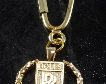 Rolls royce etsy vintage 1980s gold plated metal rolls royce collectible emblem key chain new old stock aloadofball Gallery