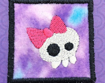 """Square Iron On Patch, Girl Skull with Pink Bow Embroidered on Purple Pink Background, about 2"""" x 2"""""""
