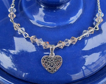 Cut Out Heart Sterling Silver Charm Necklace