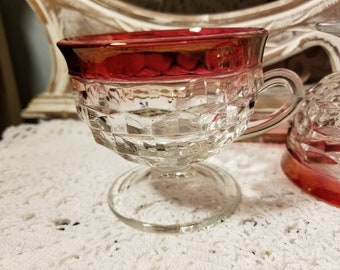 Clear and cranberry glass diamond point pedestal mugs