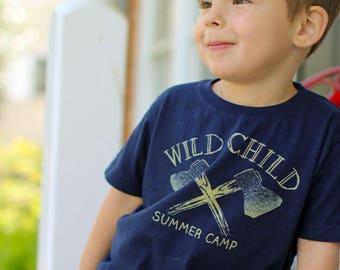 Wild Child Summer Camp : Navy Blue Kids Tshirt. Vintage distressed summer camp hatchet logo in old gold. Child Sizes 2t 3t 4t, XS-XL