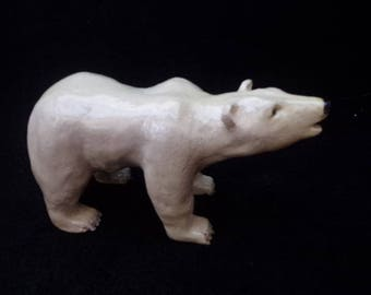 Mom bear with her enamelled white faience