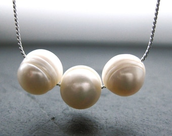 Cream Pearl Necklace. Silver. Three Little Words