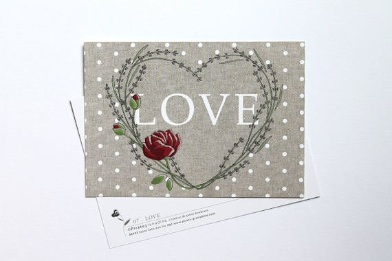 "Postcard on bottom lin ""LOVE"""