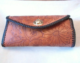 Hand tooled leather clutch purse in a flower design Made in Montana