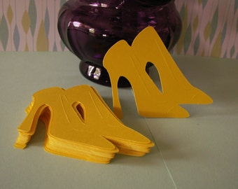 25---21/2 inch pair of yellow high heel shoes