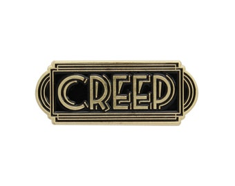 Creep black and gold enamel lapel pin