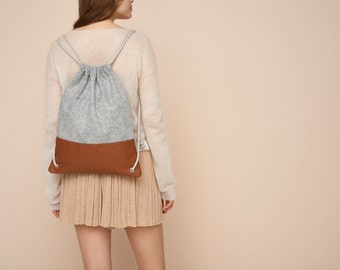 Sewing pattern and tutorial for a simple leather and felt drawstring backpack
