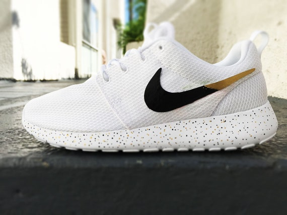 girls nike roshe gold and silver