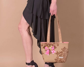Medium Maris Rae handbag tan light brown upholstery with faux sued shoulder straps & pink and gold bow