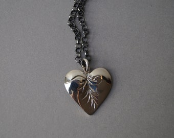 Heart pendant made of sterling silver on blackened silver necklace