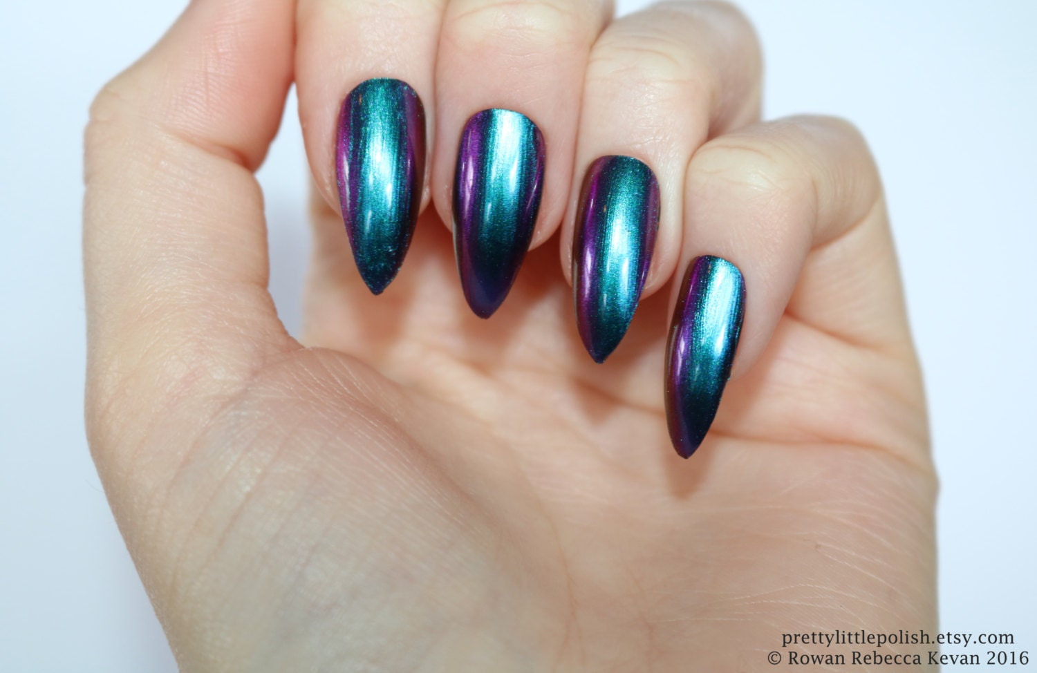 Teal and black acrylic nails