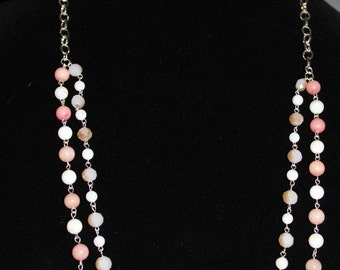 Peachy-pink on a chain necklace