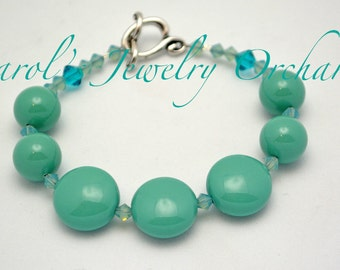 SALE Swarovski Pearl Bracelet w/ Coin Glass Pearl & Pacific Opal crystals.  One of a kind teal bracelet w/ Tierra Cast pewter Clasp. Unique.
