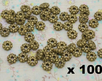 100 x Pearl spacer round metal bronze