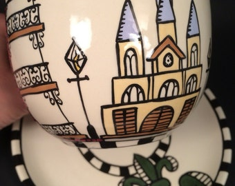 New Orleans architecture inspired cup and saucer with green fleur de lis