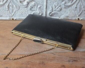 1970's Vintage Black Leather Convertible Handbag By Etra