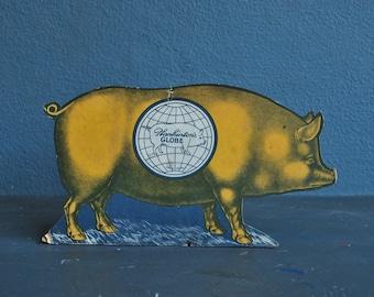 1900's Butcher Display the sad pig