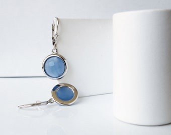 Sterling silver and light blue faceted cubic zirconia cabochons dangling from lever-back hooks