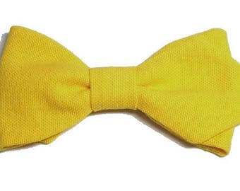 Yellow bowtie with sharp edges