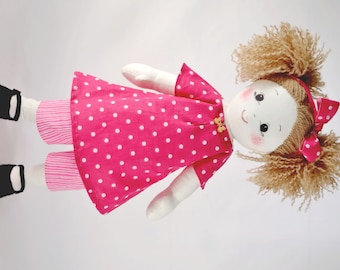 Rag doll in sewing kit