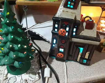 Vintage lighted Christmas tree and Halloween haunted house
