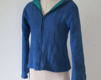 Women's fully lined blue alpaca jacket with hood.