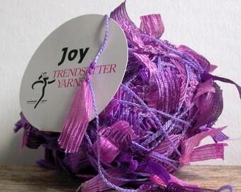 trendsetter joy yarn . lavender and lilac 1343 . pink purple ribbon flag novelty art yarn . 62yd . destash discount discontinued yarn