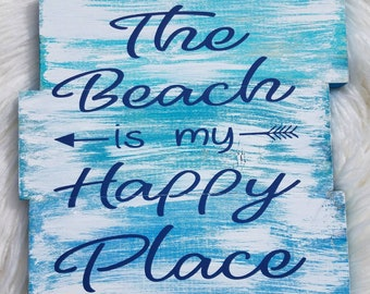 The Beach Is My Happy Place Plank Wood Sign With Multiple Shades of Blue With A White Dry Brush Finish.