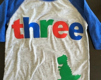 Three dinosaur t rex birthday t shirt, boys dino birthday shirt, 3rd birthday dinosaur shirt, raglan style shirt red blue green