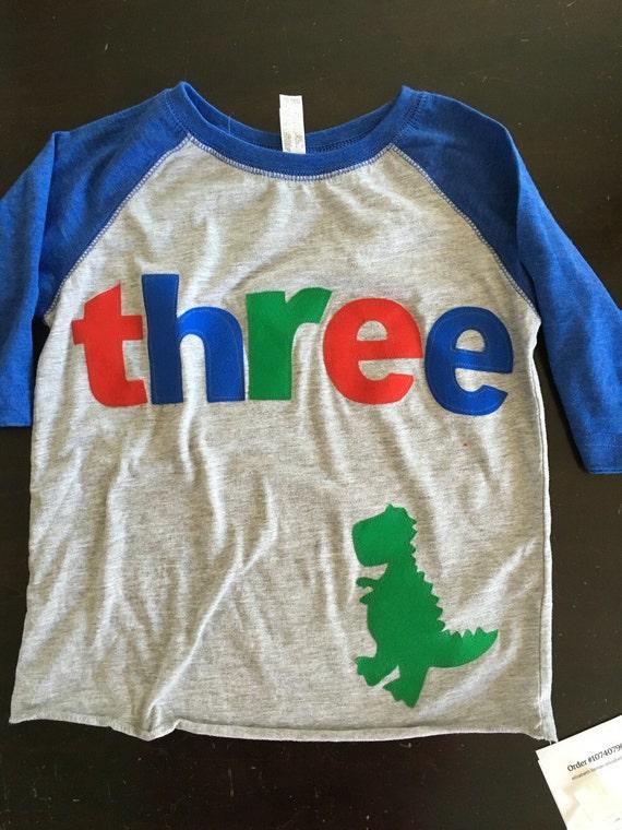 Three dinosaur t rex birthday t shirt, boys dino birthday shirt, 3rd birthday dinosaur shirt, raglan style shirt red blue green